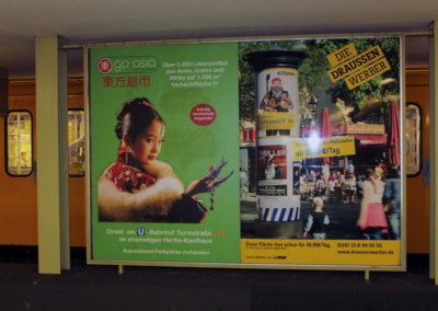 Plakat Go Asia in U-Bahnhof Scharmweber Str.